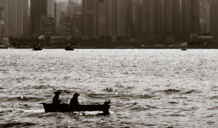 honk: Fishing boat on Victoria harbor in Honk Kong  Stock Photo