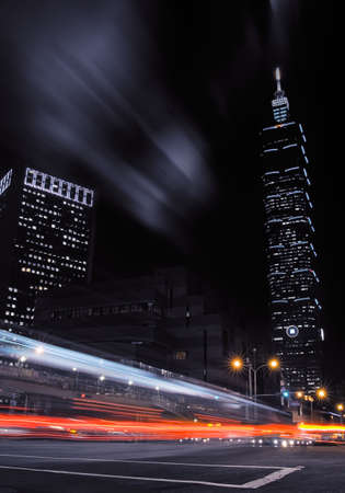 Cityscape of skycraper and cars motion blurred light in the night.  photo