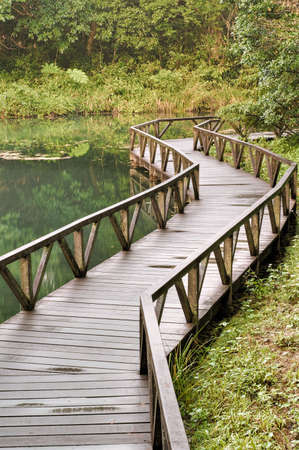 Nature scenery with bridge on lake in forest, outdoor. Stock Photo - 6053523