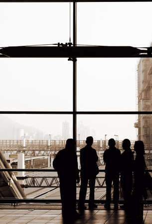 Business group silhouette standing in the modern building. photo