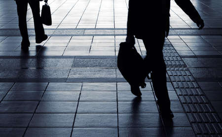 black shadow: Businessman silhouette carry briefcase and walk in corridor in motion blurred. Stock Photo