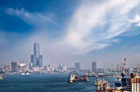 Cityscape of harbor with buildings and boats on the sea in Kaohsiung, Taiwan.
