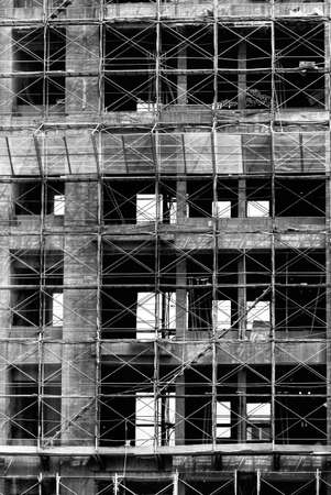 Building under construction in black and white tone. photo