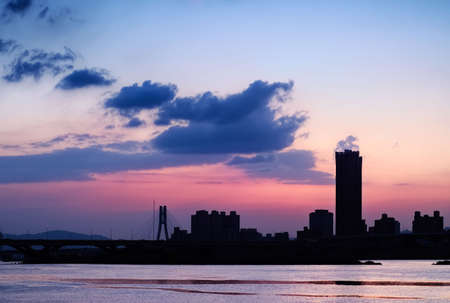 Silhouette  cityscape with beautiful sunset background and architecture beyond river in Taipei, Taiwan. Stock Photo - 6129575