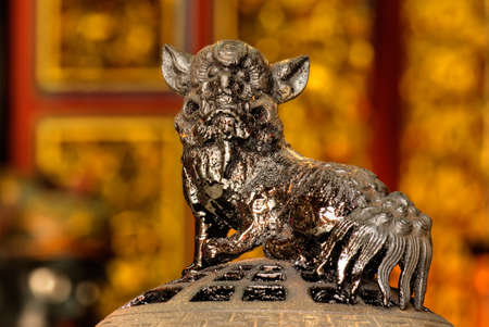 Chinese religious holy god animal of lion with black oil stand on censer. photo