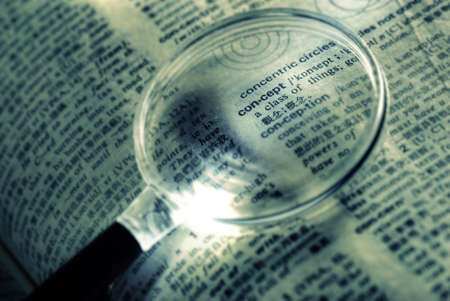 Focus on concept word with magnifier in book. photo
