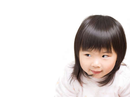 Sly Asian girl portrait with funny face.