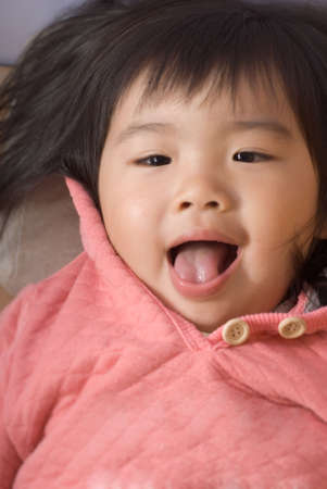 Smile Asian kid portrait on the bed. photo