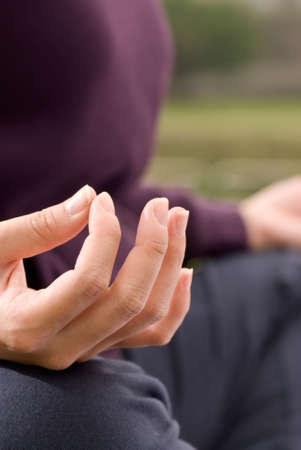Yoga pose of lotus of woman hand in outdoor. Stock Photo - 6418219