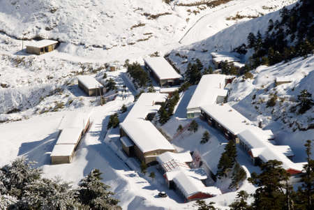 Snow town in winter with white buildings and house. photo