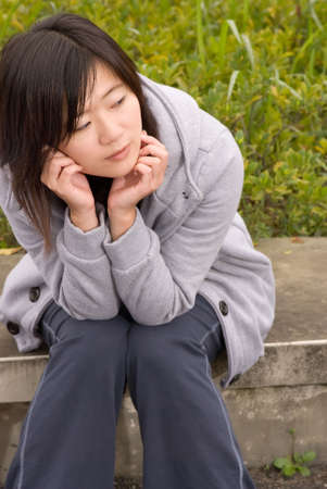 Woman sit and wait in park of outdoor. Stock Photo
