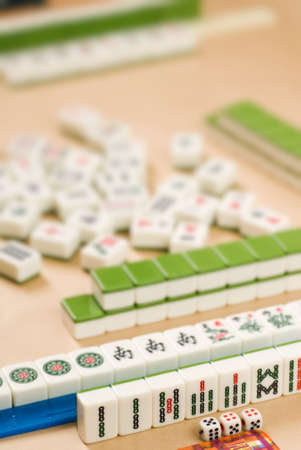 Gambling in Chinese ¡V Mahjong ¡V traditional game with friends. Stock Photo - 6480624