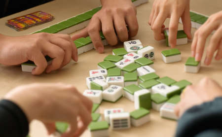 mahjong: Gambling in Chinese  Mahjong  traditional game with friends. Stock Photo