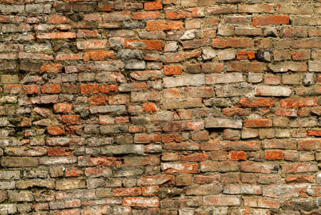 Old and discarded brick wall background in red and yellow color. Stock Photo - 6519600