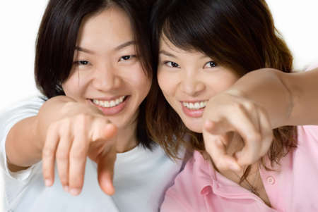 Happy smile friends of Asian women pointing. photo
