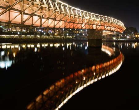 Color bridge in night of city in Kaohsiung, Taiwan.