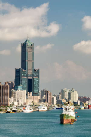 taiwan scenery: Cityscape of harbor with freighter on ocean and skyscraper in day in Kaohsiung, Taiwan.