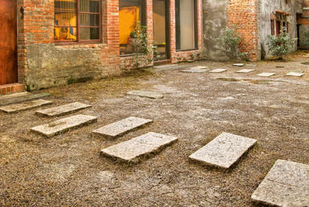 Path of stone in yard of old building. photo