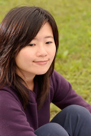 Smiling Asian beauty portrait in outdoor of park. photo