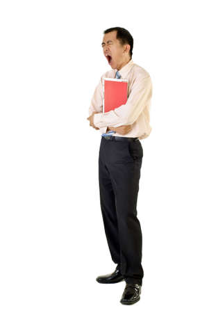 Tired businessman holding folders yawning on white background. photo