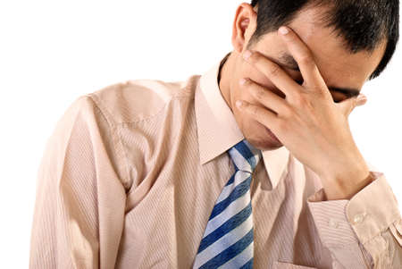 Sad businessman portrait of Asian on white background. photo