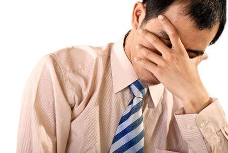 Sad businessman portrait of Asian on white background.