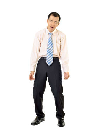 Tired businessman standing feebly on white background. photo