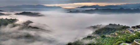 Panoramic landscape of dramatic clouds and mist in mountain. Stock Photo - 6783956