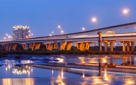 Color city scenic with modern bridge and light over river. Stock Photo - 6784046
