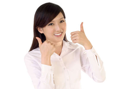 Happy business woman with ok gesture on white background. photo