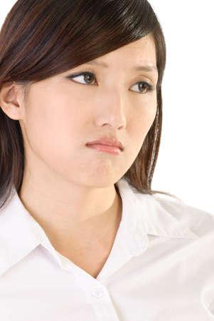 caras tristes: Empresaria preocupada de Asia con cara azul de expresi�n sobre fondo blanco.