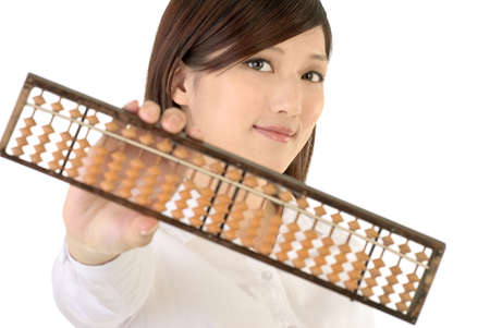Chinese businesswoman with abacus on white background. photo