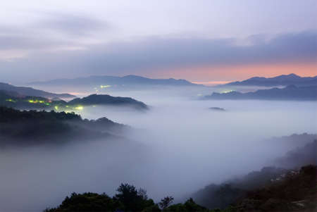 Landscape of mist scenery in hill of rural in dawn. photo
