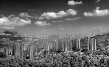 Beautiful cityscape of building near mountain in Hong Kong. photo