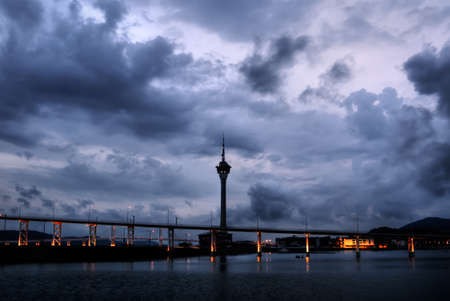 Cityscape in Macao with dramatic clouds and travel tower silhouette in night. Stock Photo - 7005554