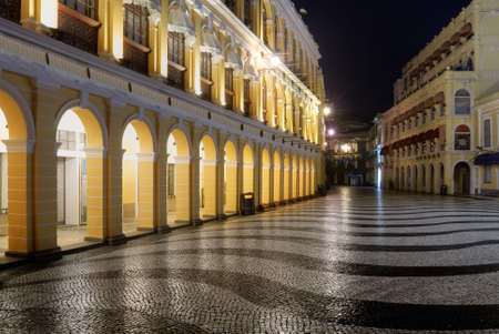 Macao landmark - Senado Square with European buildings and elegant wavy patterns in night.