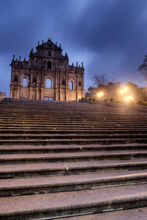 Macao landmark - Ruins of St. Pauls with stairs and lamp in night. photo