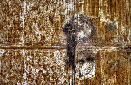 Rusty metallic door background with one lock. Stock Photo - 7005693