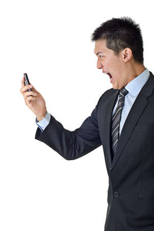 Angry businessman yelling to cellphone on white background.