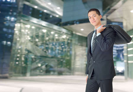 Happy young businessman of Asian outside of office. photo