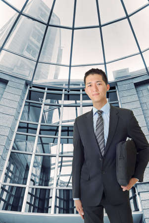 Young businessman of Asian stand inside modern building. photo