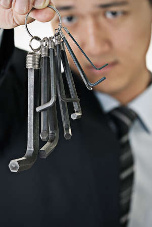 Businessman hang up tools on hand and watch. photo