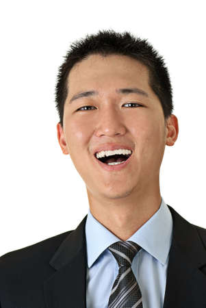 Closeup portrait of Asian smiling young business man against white. photo