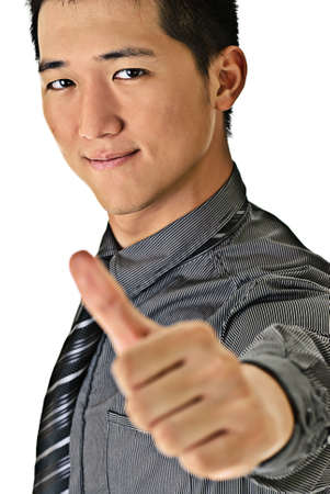 Happy handsome business man of Asian giving you a thumbs up sign isolated against white. photo