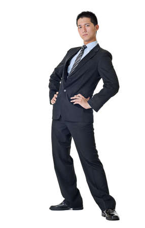 Full length of a handsome business man of Asian standing with funny pose against white. photo