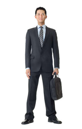 Full length portrait business man with briefcase isolated against white. Stock Photo - 7135327