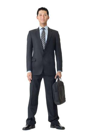 black briefcase: Hombre de negocios de retrato de longitud completa con Malet�n aislado contra blanco.  Foto de archivo