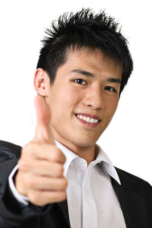 Happy young business man of Asian giving you a thumbs up sign isolated against white. photo