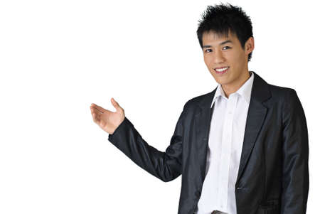 Portrait of a happy business man of Asian showing something on white background. photo