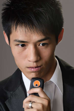 Portrait of handsome business man of Asian with cellphone. photo